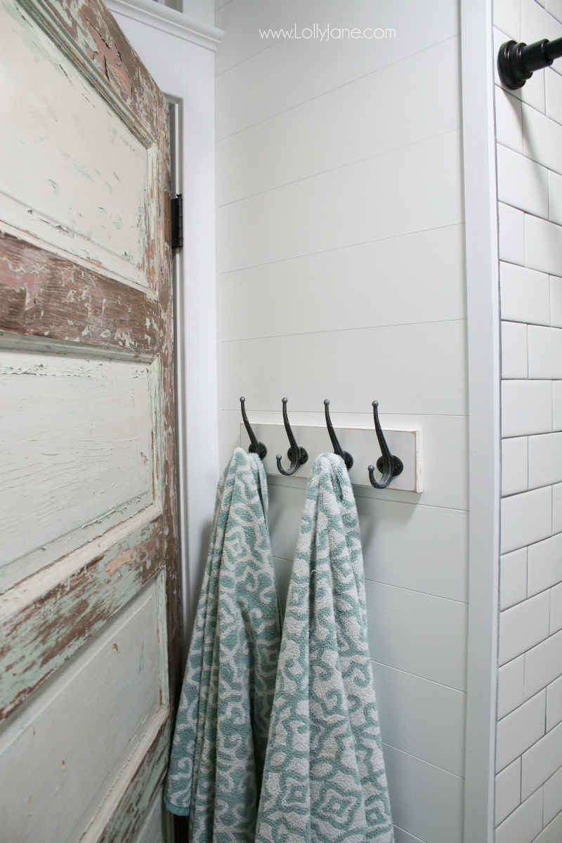Loving this shiplap bathroom remodel! Classic farmhouse renovation ideas, love this old door with new tile to mix vintage and modern.