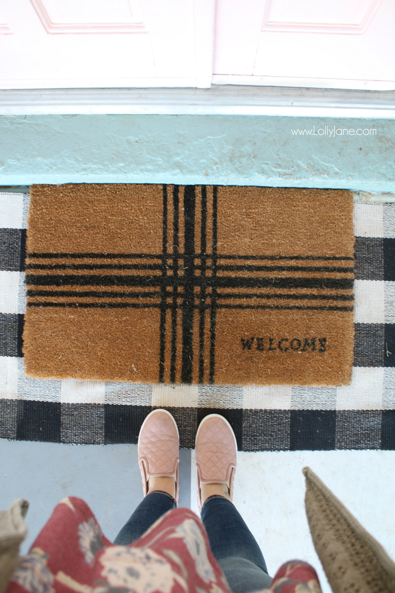 Loving this buffalo check and welcome mat layered rug front porch combo! Such a happy front porch with pink painted doors!