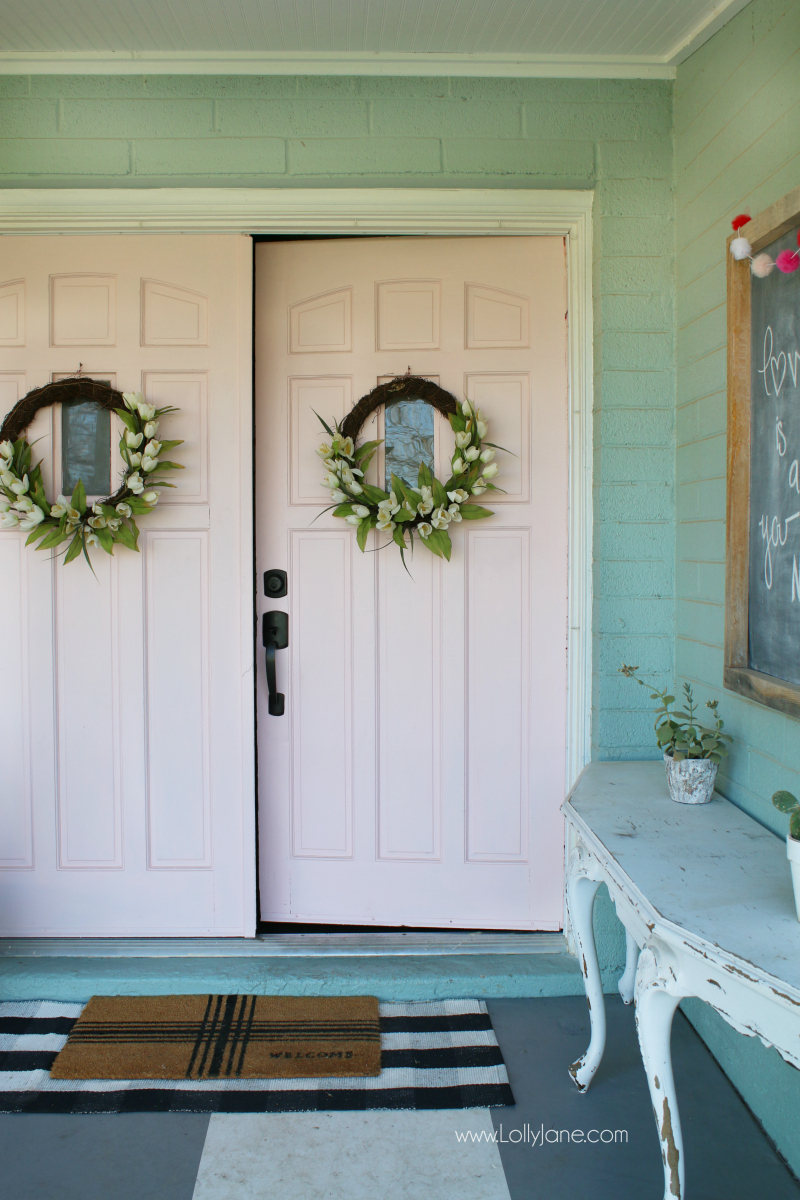 Freshly painted pink front doors make cute porch decor! Love these happy spring doors with a fun sign tutorial in the link!