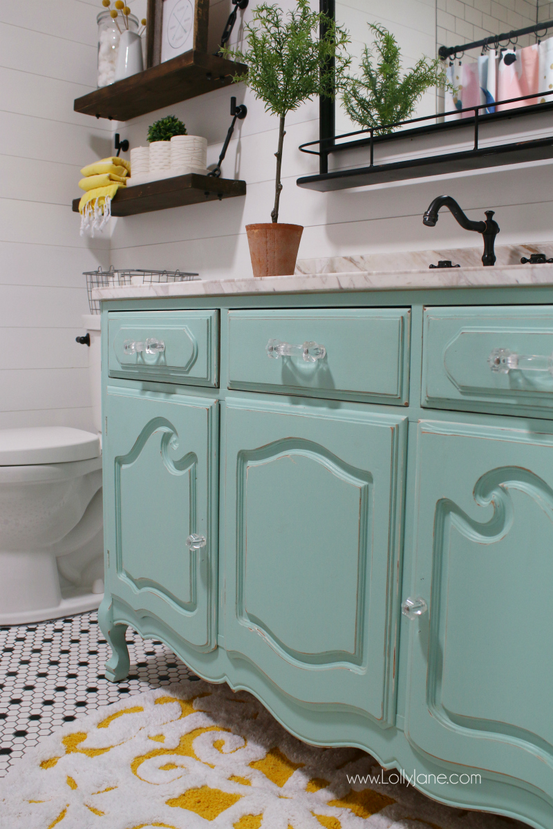 Loving this aqua vanity bathroom decor. This old dresser painted with a new marble top makes a great custom farmhouse bathroom vanity!