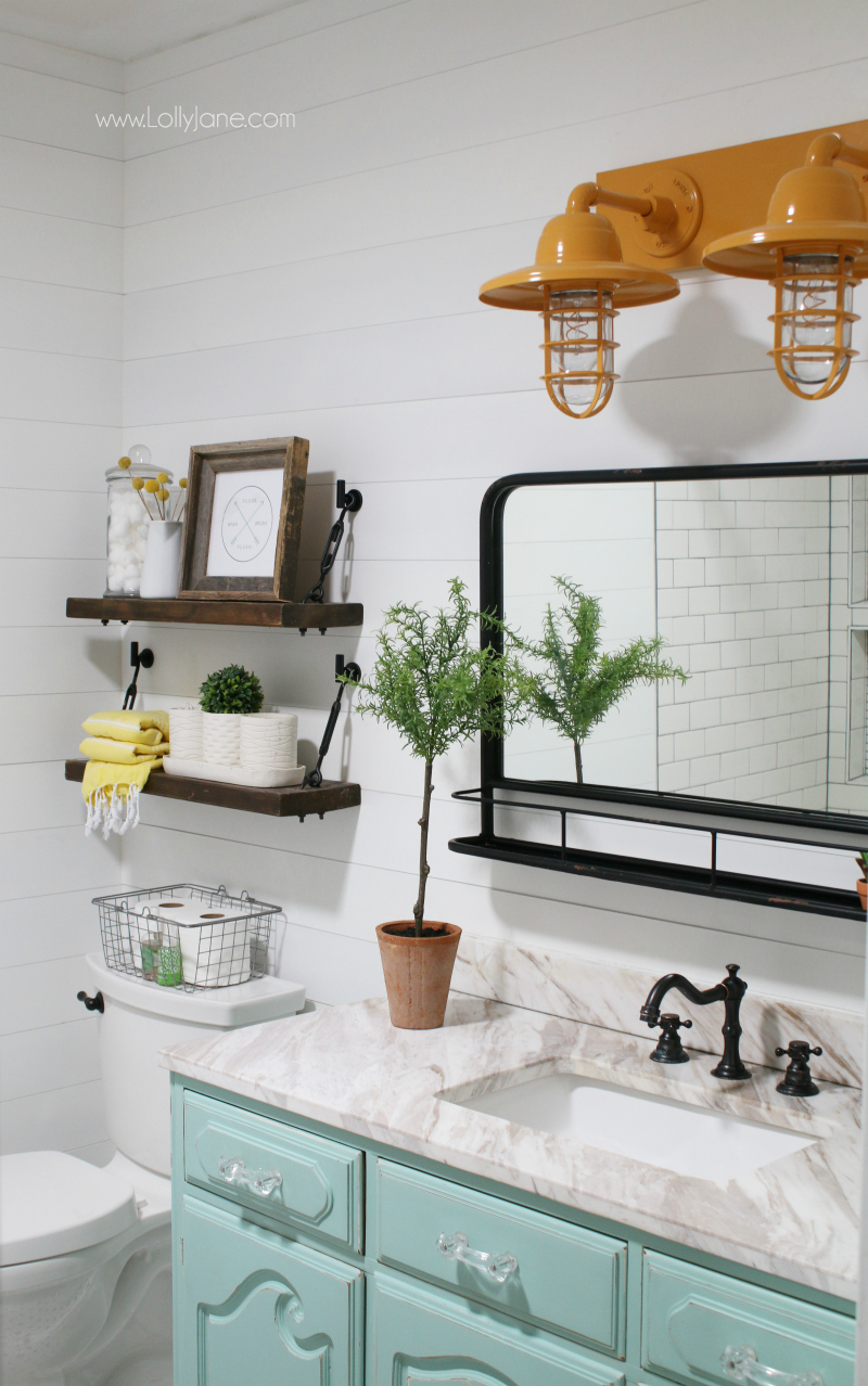 Loving this aqua vanity farmhouse bathroom decor with the mustard yellow barn lights and pharmacy mirror!