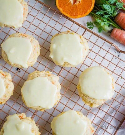 iced carrot cookies recipe - Such an easy carrot cookies recipe with orange glaze frosting. This zesty orange glaze for carrot cookies are the perfect topping for our light and fluffy carrot cookies!