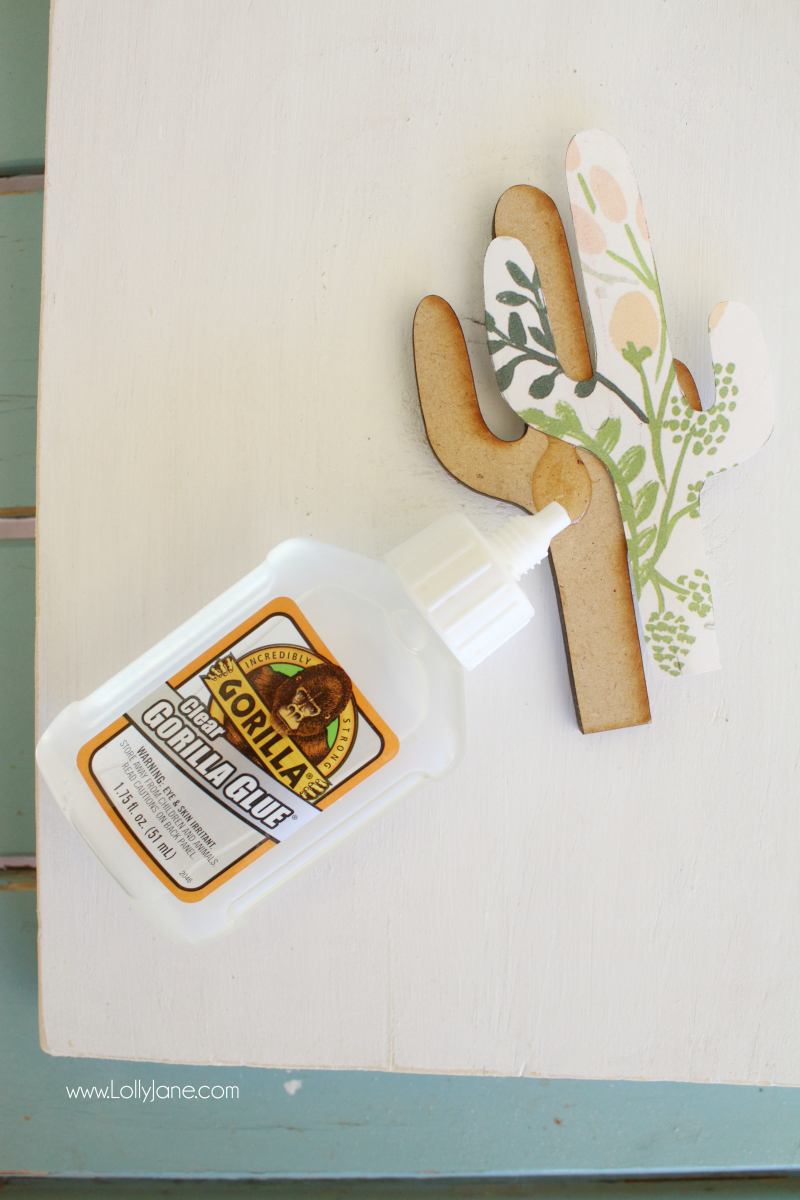 How to decoupage with gorilla glue a wood cactus cutout. Makes a cute wood home decor sign!