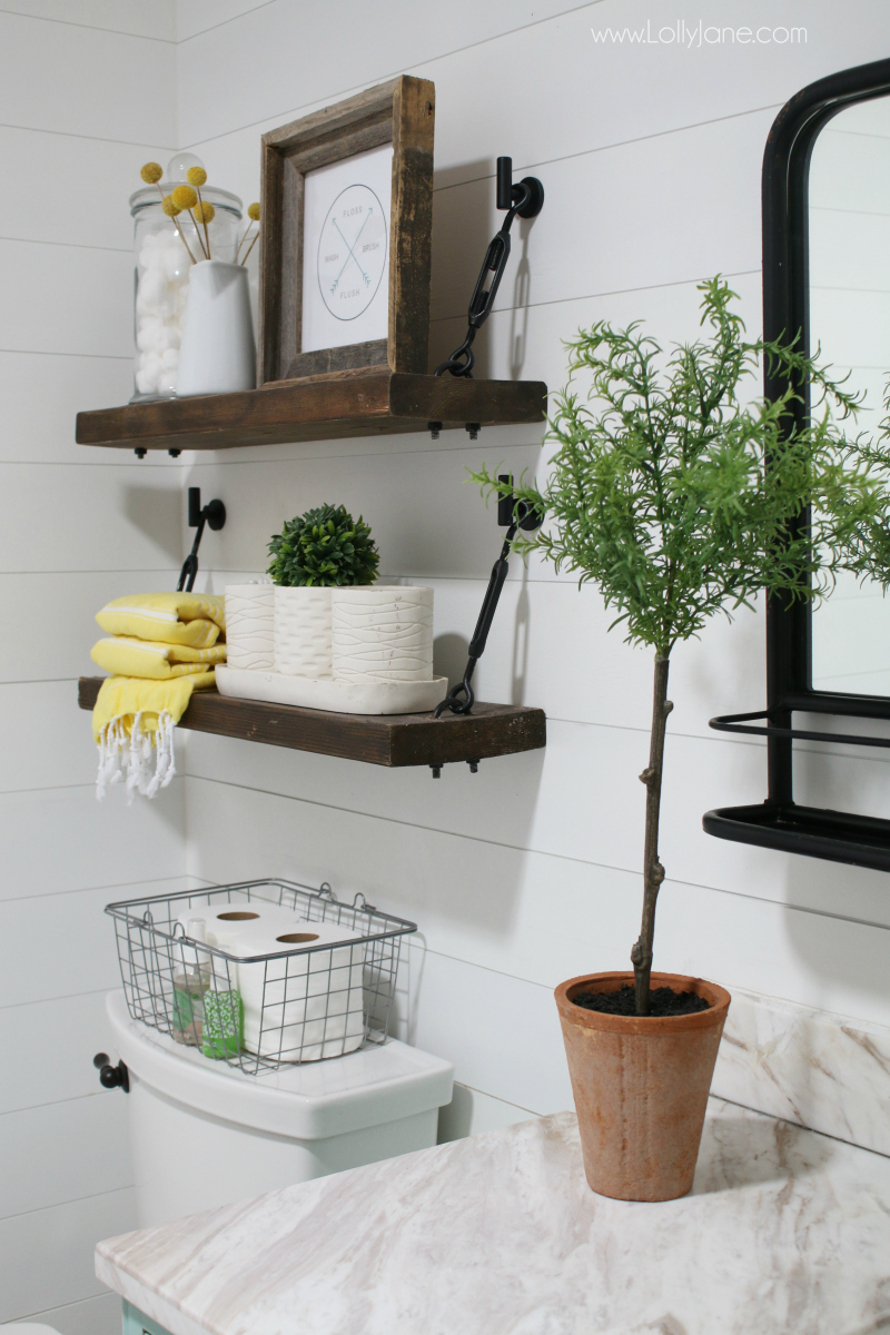 These DIY Turnbuckle Shelves in this farmhouse bathroom decor look awesome in this colorful bathroom remodel. Loving the pops of yellow in this guest bathroom!