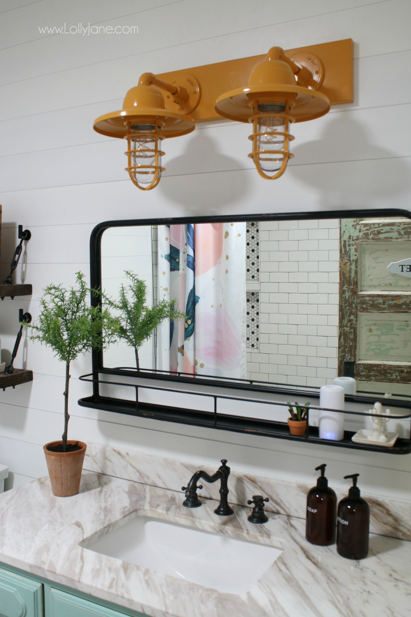 Colorful farmhouse bathroom decor ideas. Love this mustard barn light bathroom vanity, it looks great paired with the aqua DIY vanity!