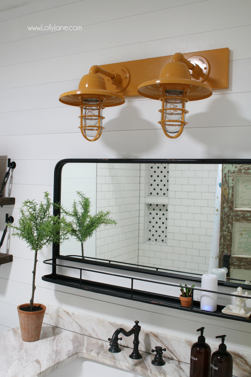 So in love with this mustard yellow bathroom light decor! A vintage bathroom light is the perfect accessory to this bathroom renovation.