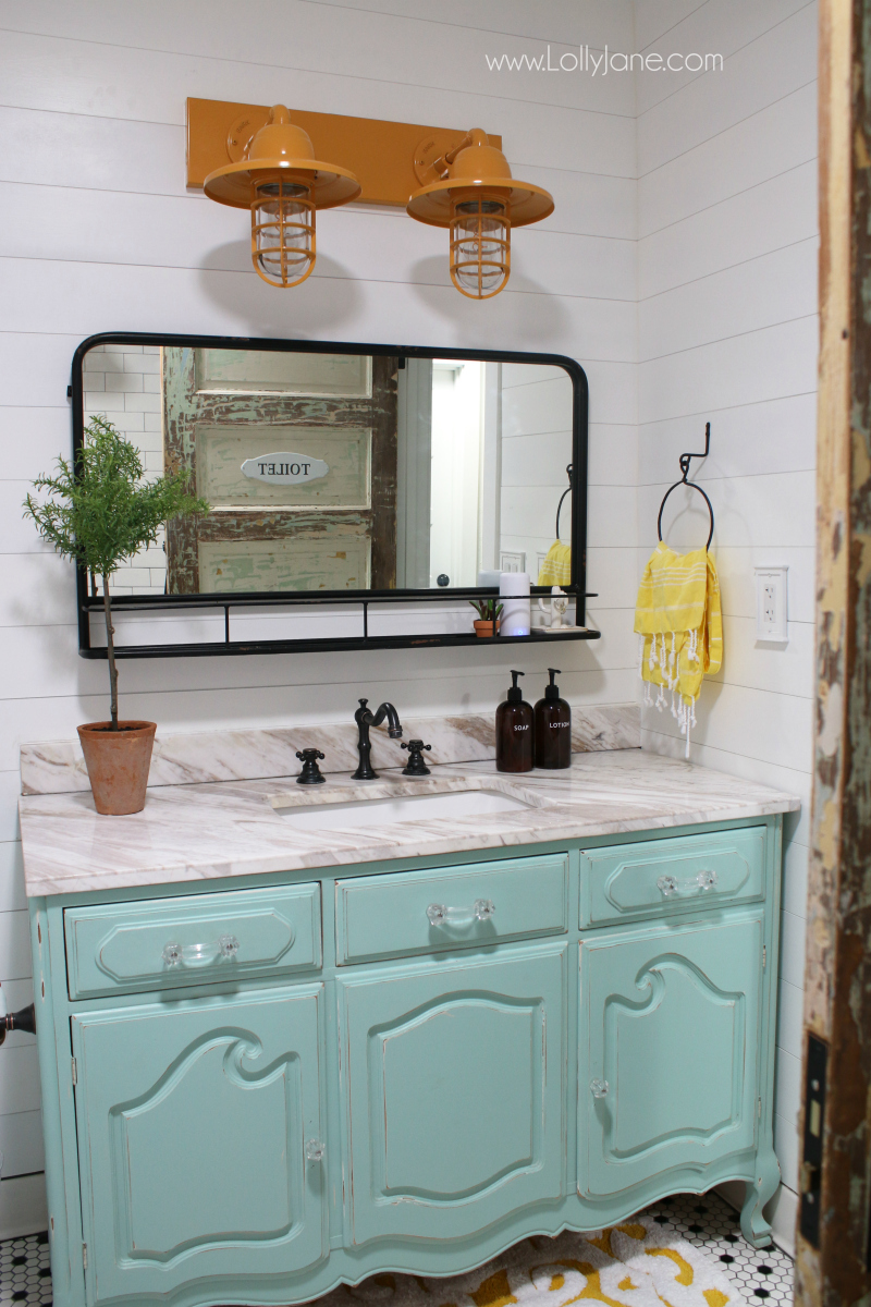 Loving this pharmacy mirror in this farmhouse bathroom decor. Such a pretty pharmacy mirror in our recent bathroom remodel!