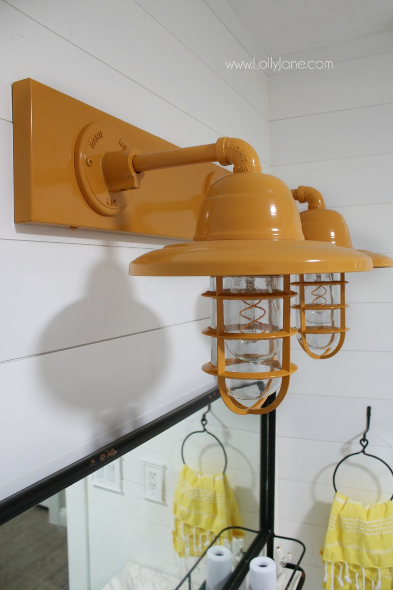 farmhouse bathroom vanity lights - So in love with this yellow barn light bathroom decor in this farmhouse renovation.