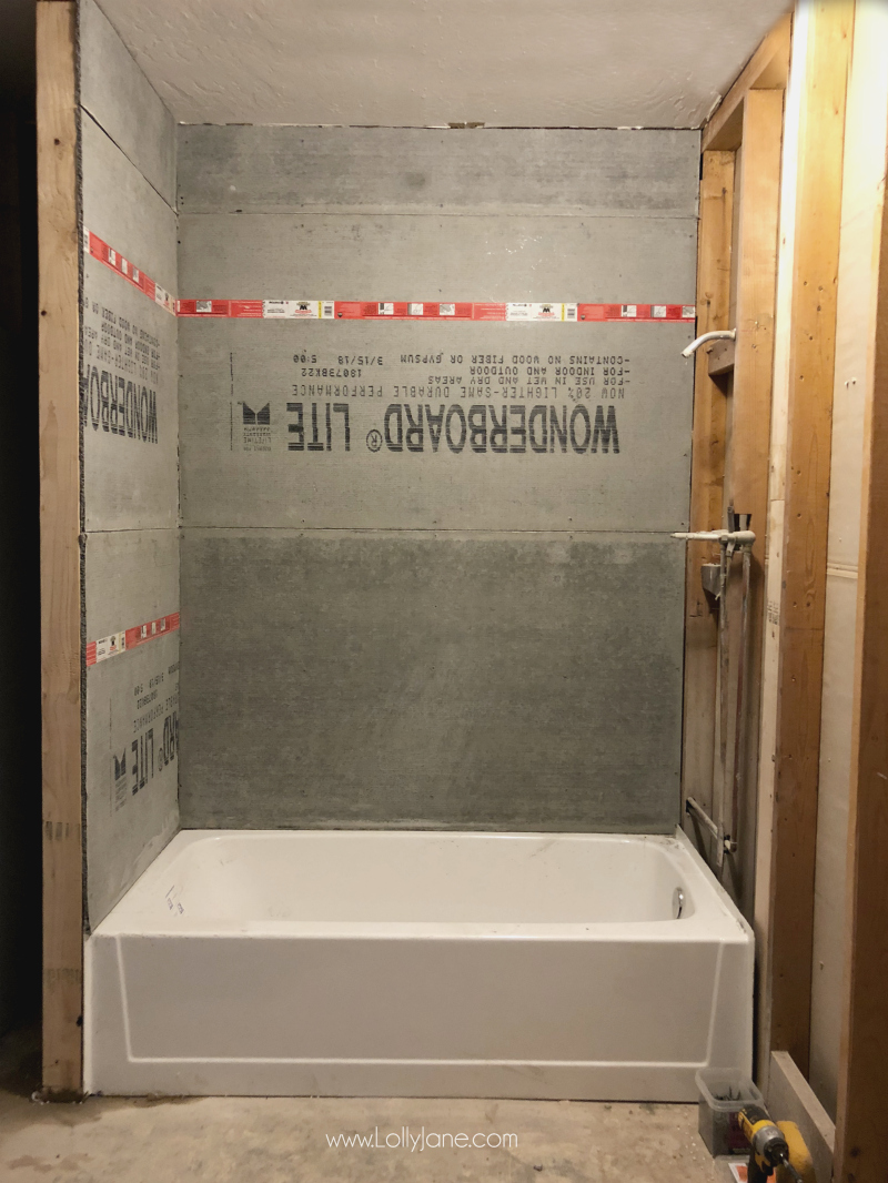 Turning a shower into a tub shower combo renovation, love how this farmhouse bathroom renovation is coming along!