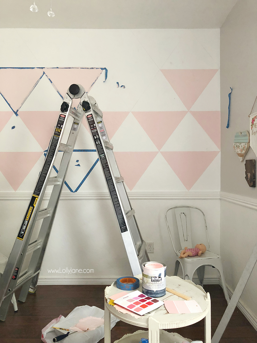 This triangle DIY Accent Wall was SO easy to create and really makes the colors in this space POP! Super easy and you just need a few supplies to get started! Click to see the after... WOW!!!