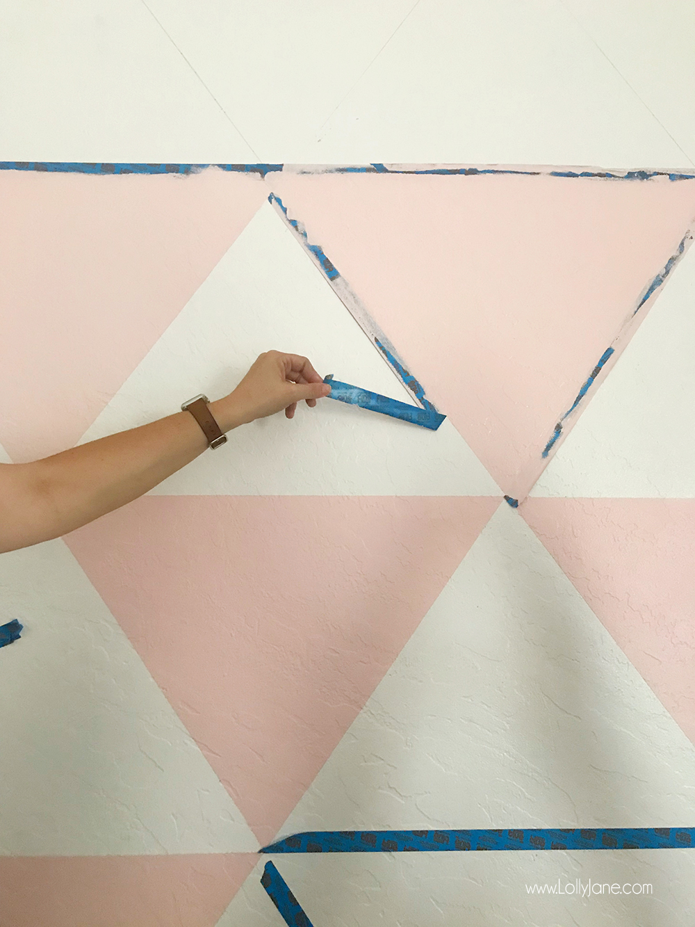 Love this DIY Triangle Accent Wall! It was so easy to create... a little painters tape and Behr paint make the perfect combo to spruce up this space!