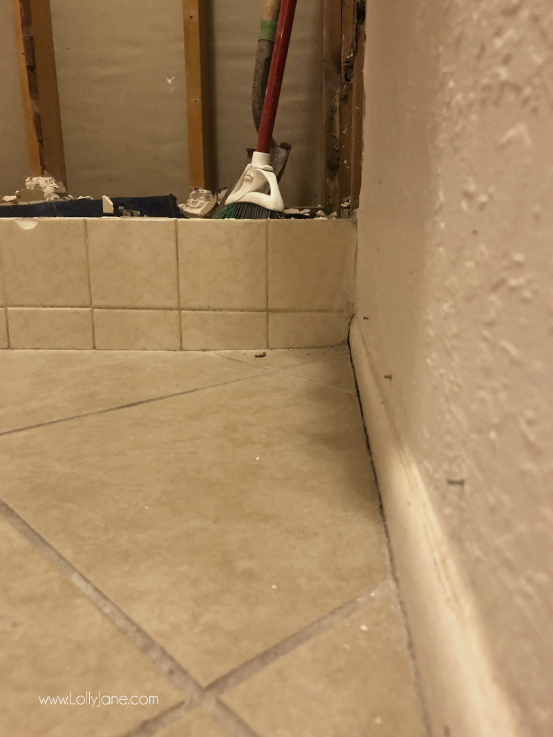 DEMO DAY! Tearing out this ugly bathroom tile to replace it with white penny tile and dark grout is going to make this modern farmhouse bathroom renovation so glam and gorgeous!
