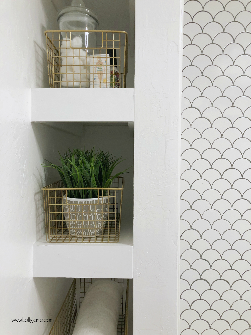 Can't decide if the DIY spray painted gold baskets are cuter OR the amazing built-in bathroom storage shelving... a FAB glam farmhouse bathroom makeover!