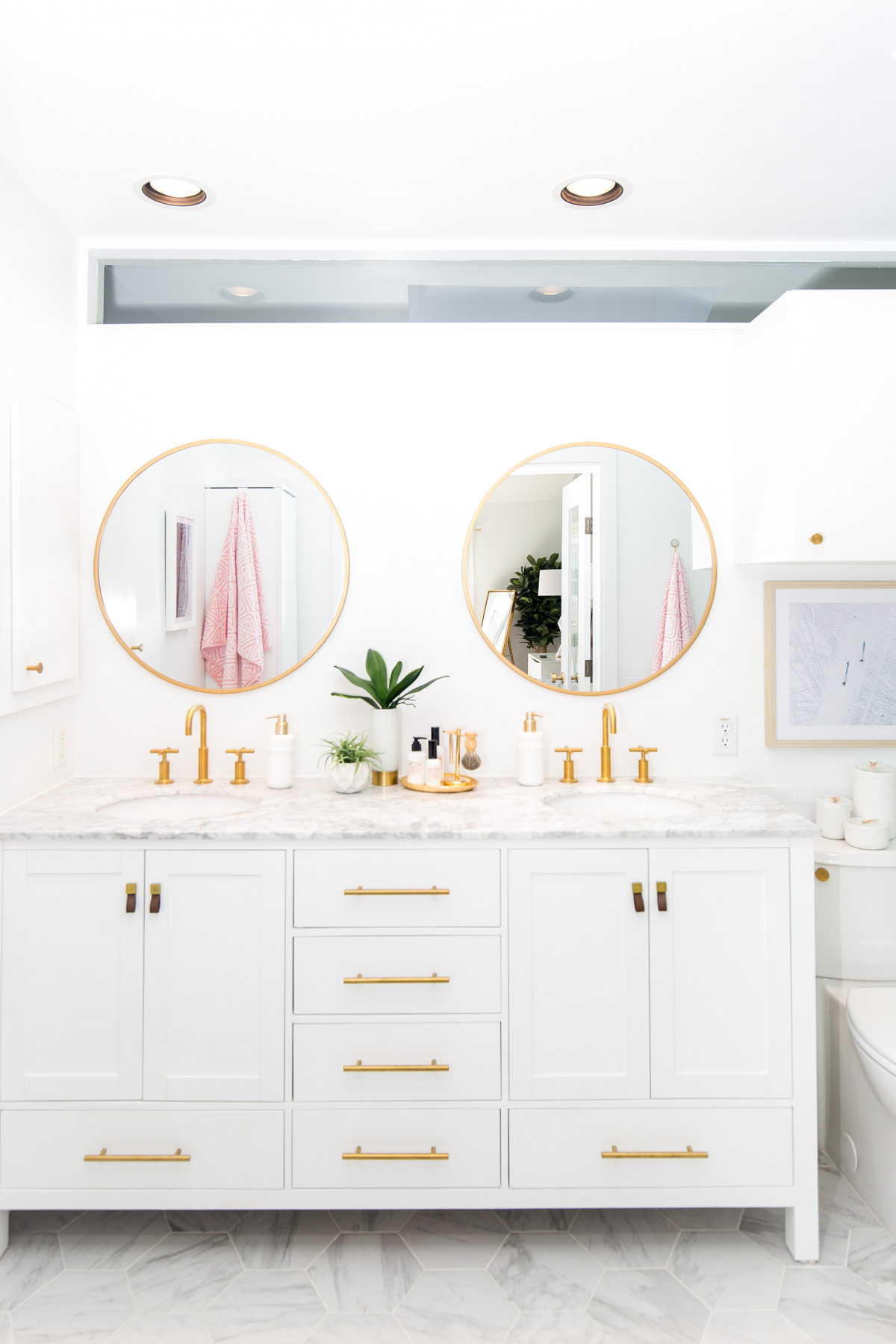 Pretty circle brass rim mirrors in this bathroom remodel make this bathroom decor! Such a pretty bathroom remodel, love it!