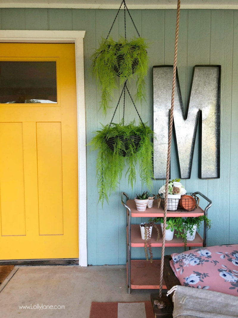 Tips for decorating with hanging plants on a porch. We love ferns and the color and texture they provide when decorating a back porch!