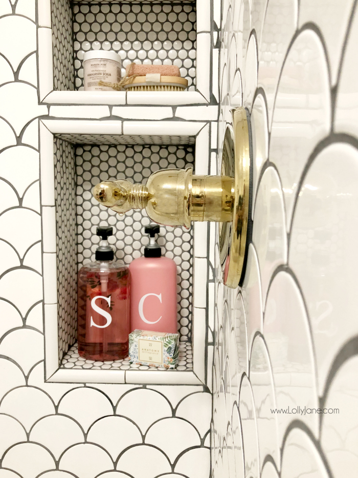 Built in shower tub combo shelf with pretty fan tile and penny tile, love this farmhouse bathroom remodel!