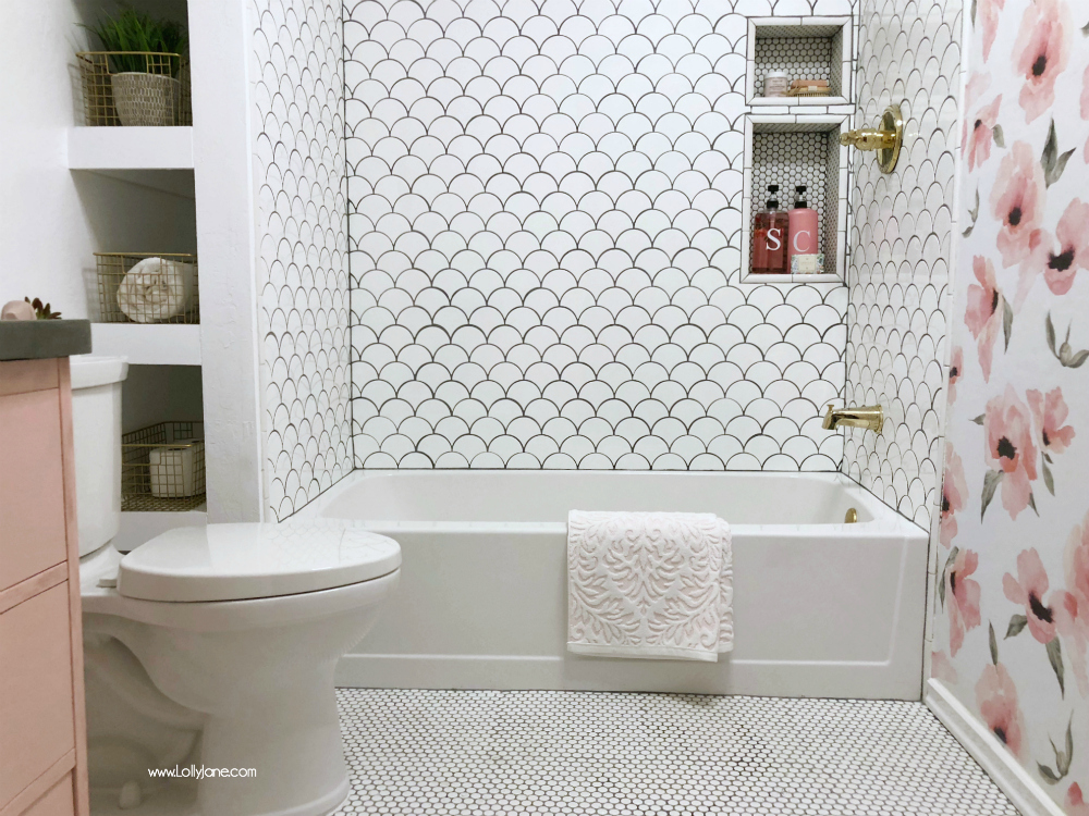 Obsessed with this GLAM fully renovated farmhouse bathroom with pops of gold and pink. SO GORGEOUS!