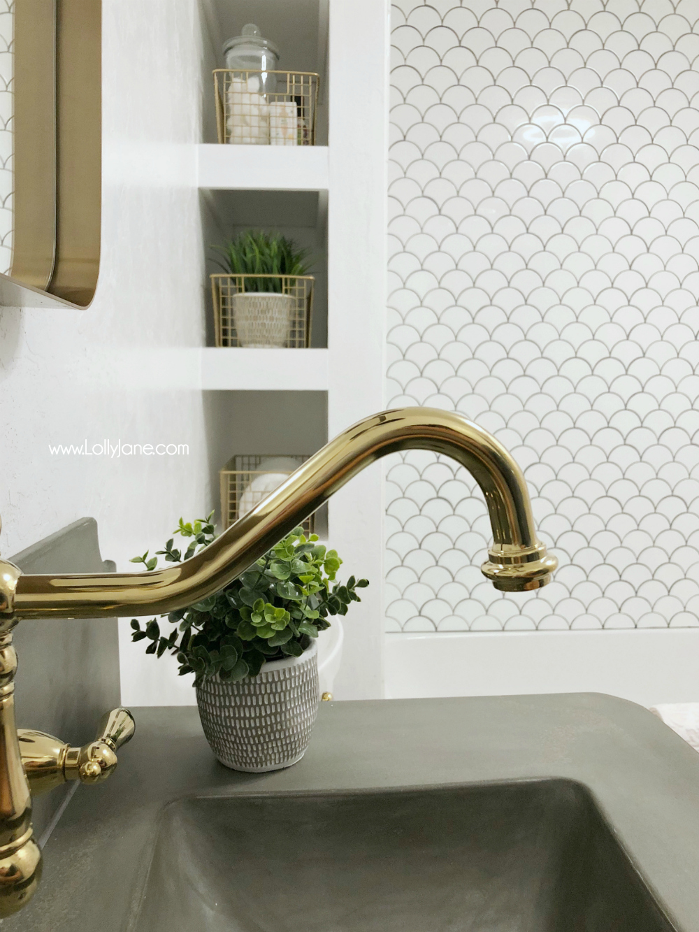 Sophisticated renovated farmhouse bathroom with pops of gold and bronze. Love this reveal!