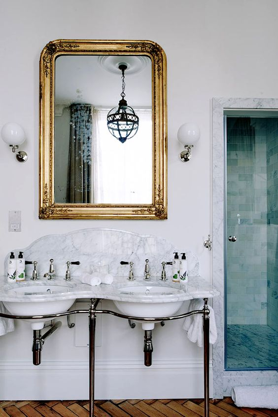 Lovely gold mirror with a modern bathroom remodel, so pretty!!