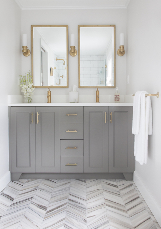 Love this modern gray vanity bathroom remodel with the gold rectangle mirrors, so pretty!