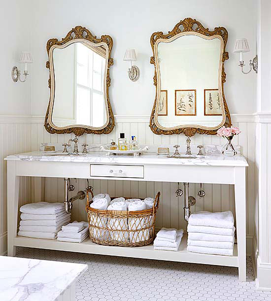 Love these pretty ornate mirrors with a white vanity in this bathroom remodel. Adore this modern bathroom remodel with brass accessories!