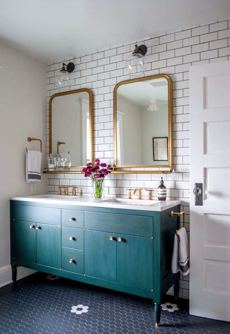 Love this turquoise bathroom vanity with gold rim mirrors in this bathroom remodel! Such a pretty bathroom with the subway tile and dark grout!