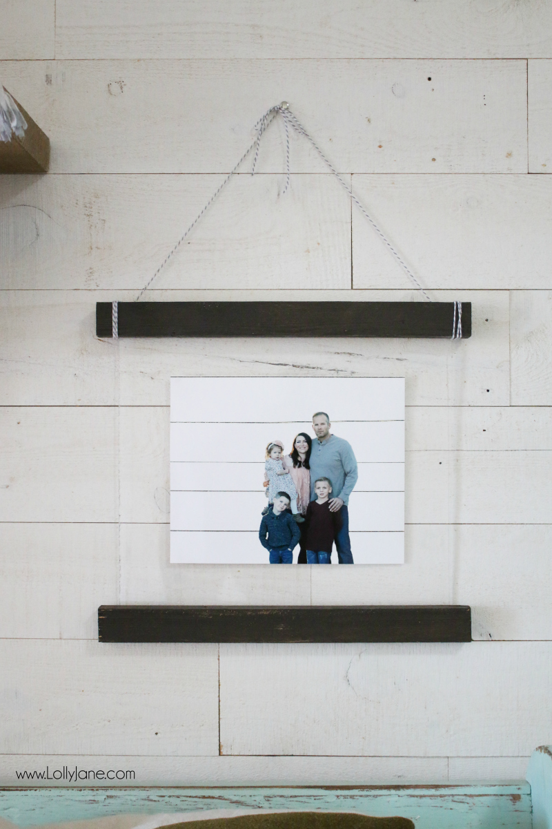 Love this easy to make diy acrylic scroll wall hanging. Such a fun way to display pictures! Love the use of plexiglass + wood, cute wall decor! #diy #shiplap #woodscroll #walldecor #pictureframetutorial