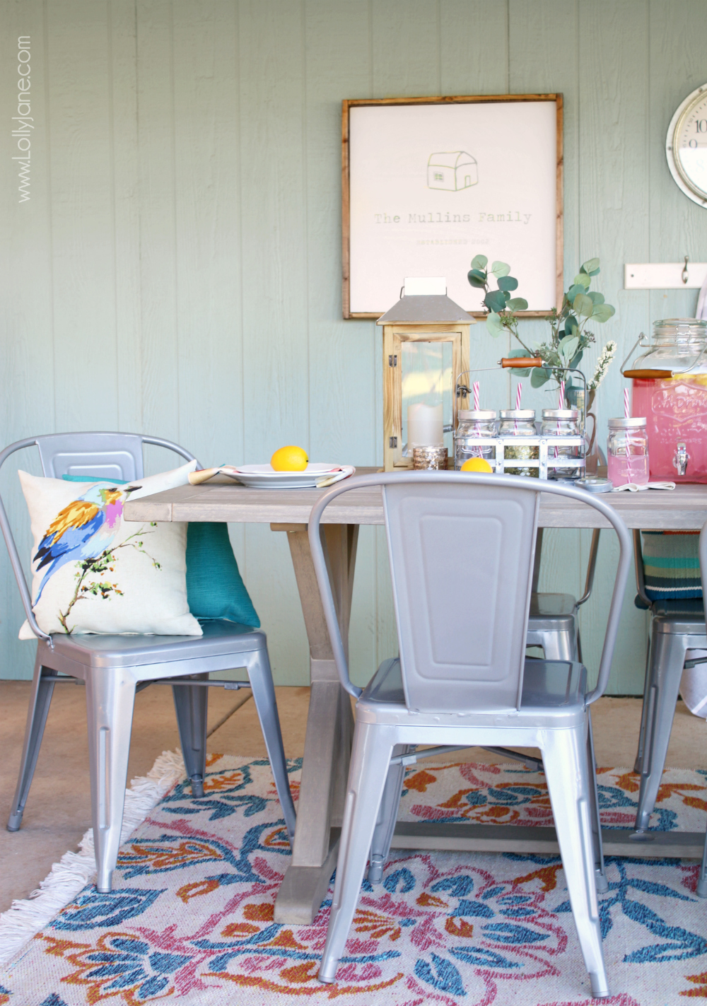 Easy-peasy tips on how to Style Your Porch for Summer. Love the neutral farmhouse table paired with these metal chairs and galvanized accent pieces, so versatile for year-round entertaining!