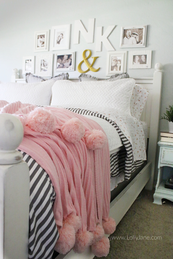 Cozy farmhouse master bedroom decor ideas. Love this soft master bedroom bedding. How to layer a coverlet with a duvet, love this gray and white striped duvet with a white herringbone coverlet and soft floral sheets.
