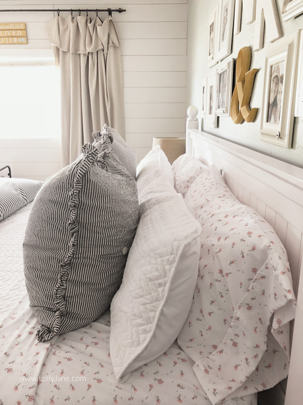 Floral striped bedding master bedroom decor ideas. Love this fun patterned master bedding. Love the layered coverlet and duvet for comfortable bedding you can't wait to sleep in! #masterbedding #farmhousebedding #seersuckerbedding #duvet #coverlet #howtostylebedding #homedecor