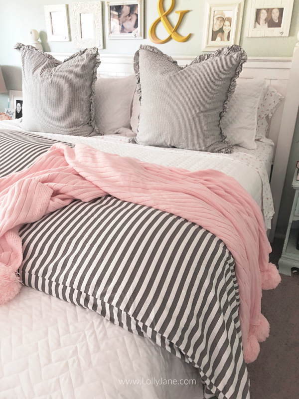 Love this soft gray white and floral bedding. Learn how to layer a coverlet with a duvet for the ultimate cozy master bedding! #masterbedding #farmhousebedding #seersuckerbedding #duvet #coverlet #howtostylebedding #homedecor