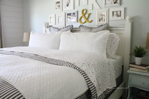 Gray white pink bedding for the master bedroom! Love this soft master bedding. Tips to layer a coverlet over a duvet, so cozy!