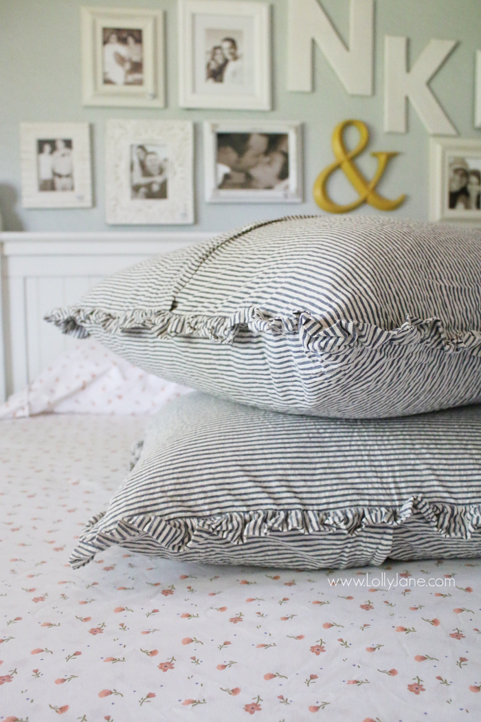 Love these ticking ruffle euro shams in this farmhouse style bedding. Learn how to layer a coverlet on your bed. Fun ways to style your bedding like a pro!