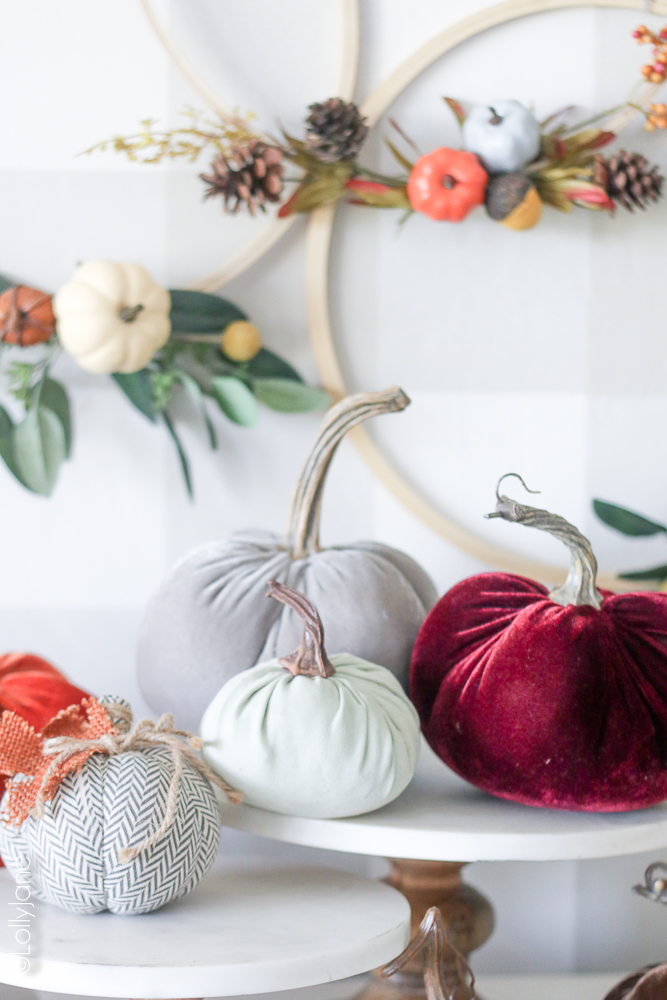 Love this cluster of pumpkins to make it feel cozy like fall. Pair with this easy DIY Pumpkin Hoop Wreath and you're set for the season! #fallwreaths #diyfallwreaths #fallwreathideas #falldoorwreaths #diy #falldecor #homedecor #fallhomedecor