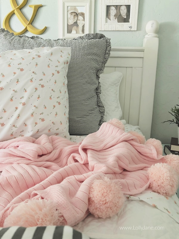 Loving these easy tips to layer a coverlet with a duvet! Crushing on this white gray pink floral striped bedding to make your master bedding feel cozy and welcoming. #masterbedding #farmhousebedding #seersuckerbedding #duvet #coverlet #howtostylebedding #homedecor