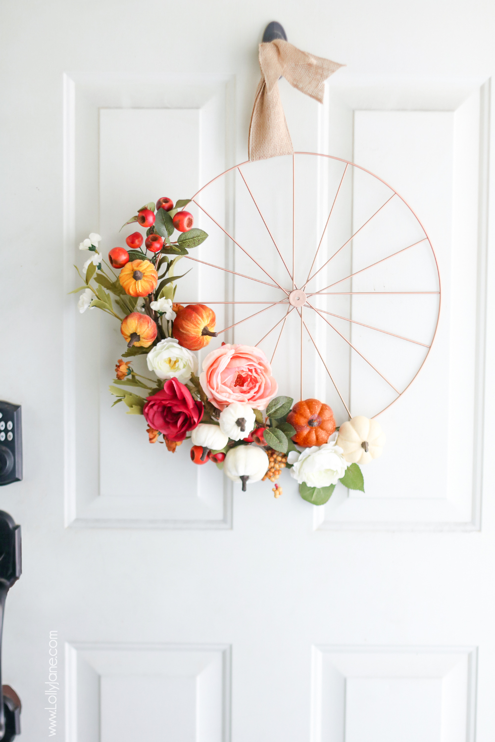 Love this EASY Fall Wheel Wreath! Grab a bicycle rim and spruce it up with fall accessories, love it! #fallwreath #autumndecor #fall #autumn #diy #fallwreaths #diyfallwreaths #fallwreathideas #falldoorwreaths #diy #falldecor #homedecor #fallhomedecor