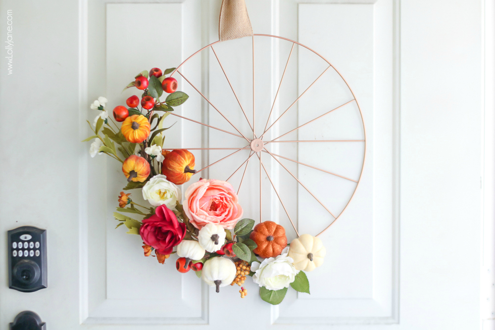 Super easy DIY Fall Wreath... love the bicycle rim look! #fallwreath #autumndecor #fall #autumn #diy #fallwreaths #diyfallwreaths #fallwreathideas #falldoorwreaths #diy #falldecor #homedecor #fallhomedecor