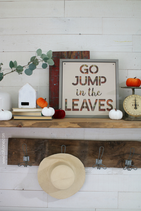 Fall mantel decor ideas to cozy up your entryway this holiday season. Love these simple fall decoration ideas to create a cozy fall mantel using a diy sign and books layered with velvet pumpkins. #falldecor #fallmantel #velvetpumpkins #pumpkinideas #falldecorations #fallmantelideas #falldecor
