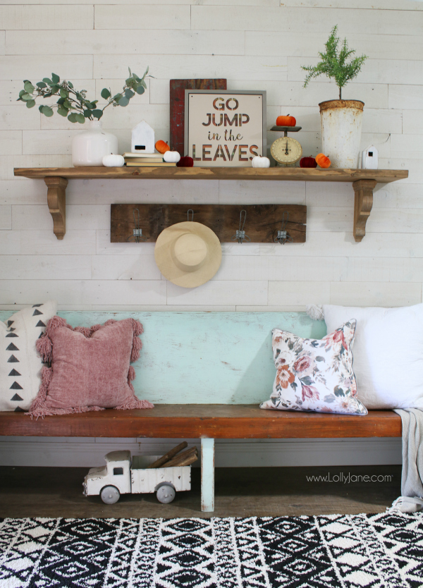 Easy fall mantel decor ideas. Love this simple fall sign paired with velvet pumpkins and eucalyptus leaves in a white vase with an olive bucket and topiary, too! Easy ways to decorate for fall to make your home cozy for the fall season. #falldecor #fallmantel #fammmanteldecor #falldecorations #fall #fallentryway