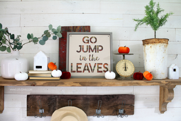 Love these fall mantel decorating ideas with this easy to make fall sign! Learn to make this plaid go jump in the leaves sign with a little painting! #falldecor #fallmantel #falldecorating #fallsign #diyfallsign #falldecorideas #fallmantelideas