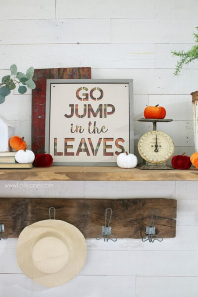 Love this easy to make fall sign! Go jump in the leaves fall sign is the perfect fall mantel decor to remember playing in the leaves as a kid. Love taking fall signs and sayings and turning them into fall signs! Learn how to make this easy fall sign to create a simple fall mantel! #fall #fallsign #fallmantel #falldecor #howto #diy #woodsign #fallideas #falldecorations