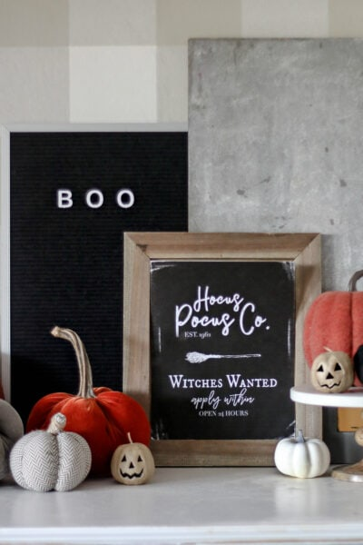 """FREE Printable Halloween Art! Print off this """"Hocus Pocus Co."""" art and display to spruce up your spooky space! #Halloweenprintables #Halloween #freeprintables #Halloweendecor #Halloweenmantel"""