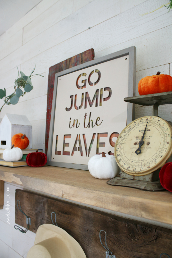 How to decorate a fall mantel. How to layer pumpkins and group fall colored items together to create a simple fall mantel! #howto #falldecor #howtodecorateforfall #fallmantel #fallmanteldecor #fallmanteldecorations #fall #fallideas