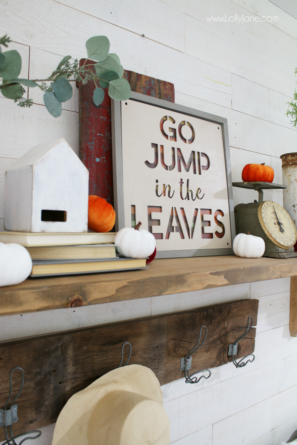 Look at this fun fall wood sign! Learn how to make a fall sign using pre-frames and laser cutouts, love the plaid paper fall sign. Such a fun Go Jump in the Leaves fall sign to add to your fall mantel decor! #fall #fallsign #fallmantel #falldecor #howto #diy #woodsign #fallideas #falldecorations