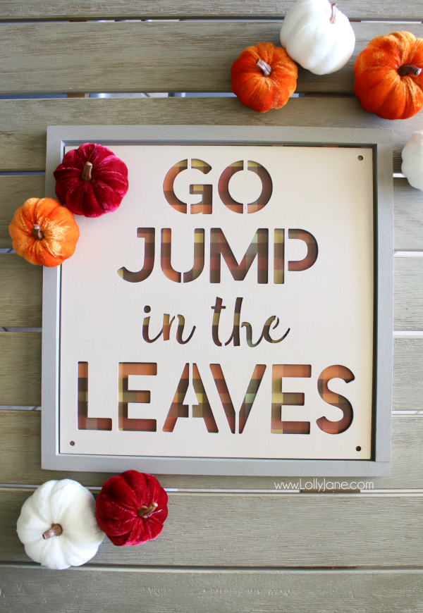 Love this plaid fall sign using buffalo check paper and a pre-made wood frame from the Simply Autumn line. This cute jump in the leaves wood sign is the perfect easy mantel decor when adding velvet pumpkins! #falldecor #plaidsign #buffalocheck #woodsign #falldecor #falldecorating #fallmanteldecor