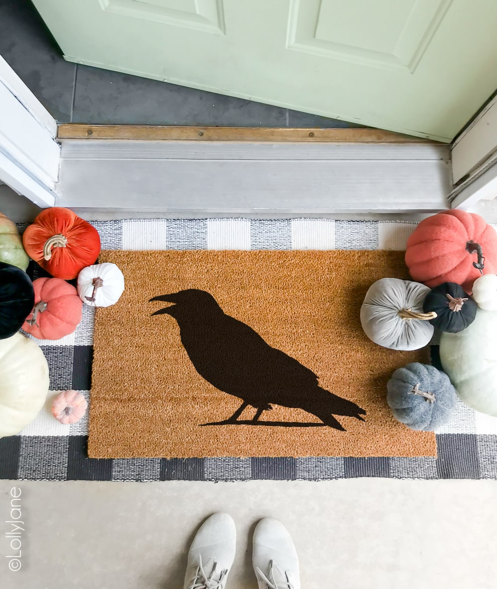 Welcome your spooky guests or trick-or-treaters with this EASY DIY Halloween Doormat... use a few supplies + minutes and transform a blank doormat into a fun piece of Halloween decor! Click picture for the full tutorial at LollyJane.com! #diy #halloweendecor #diydoormat #halloweendecor #crow #halloweendiy