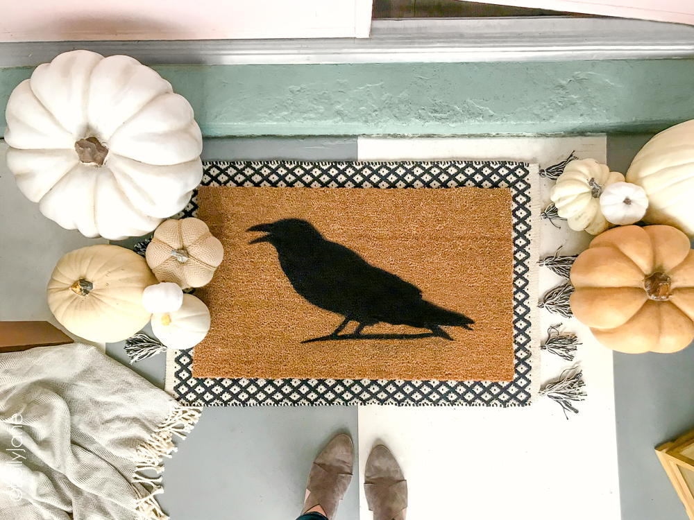 Make this spooky fun Halloween doormat for less than $15 and in minutes! FREE cut file for this cute crow... craft night, anyone? Click picture for the full tutorial at LollyJane.com! #diy #halloweendecor #diydoormat #halloweendecor #crow #halloweendiy
