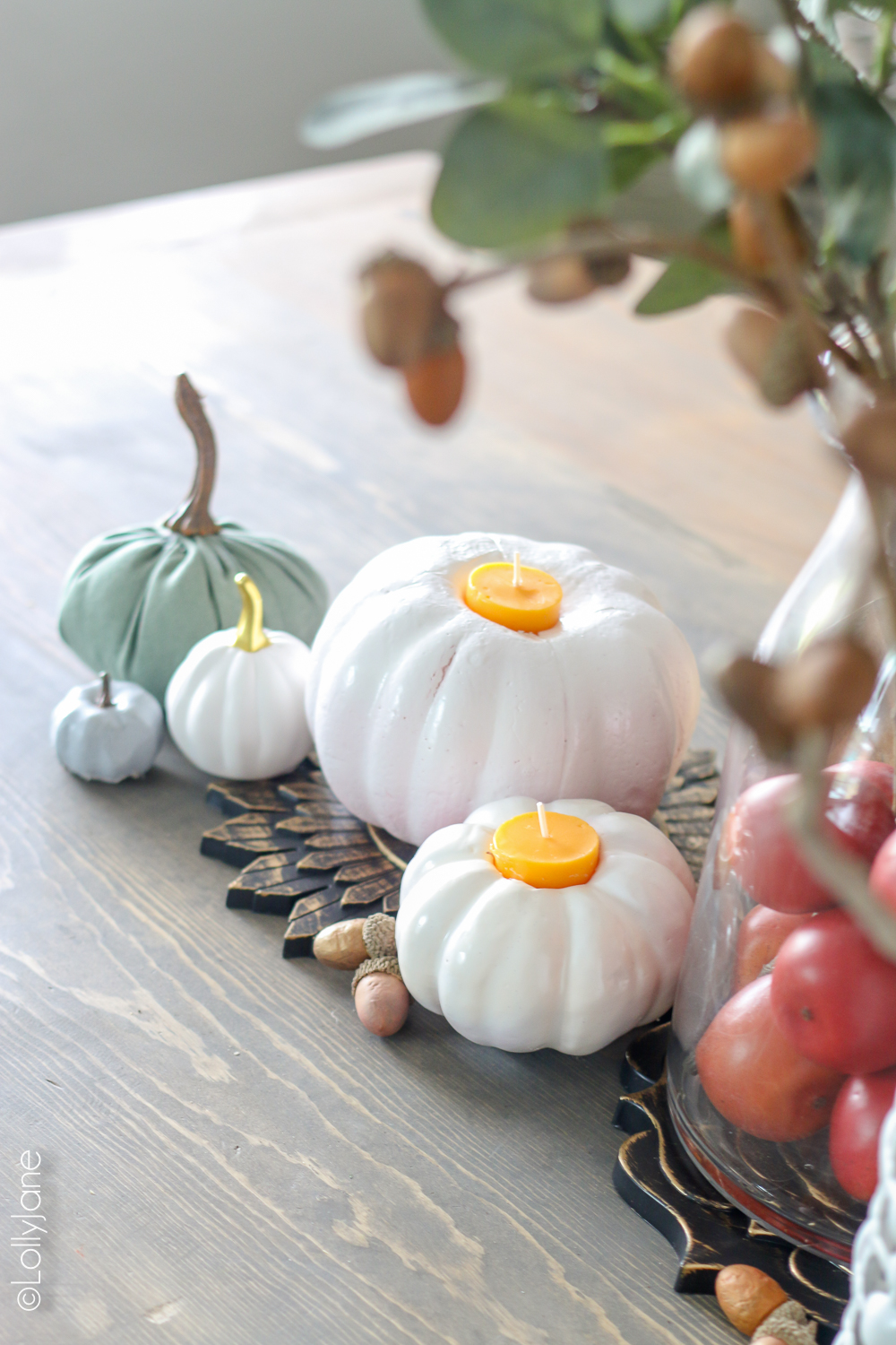 Plop a candle from the dollar store into a painted dollar store pumpkin to add some ambience and class to your fall table! Total cost, $2, wow!! CLICK to see other dollar store fall crafts! #diy #easytutorials #fallcrafts #falldecor