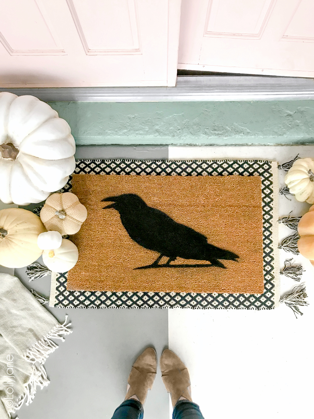 Super cute DIY Halloween Doormat... EASY to make in just minutes and for under $15! Great addition to welcome your spooky guests or trick-or-treaters! Click picture for the full tutorial at LollyJane.com! #diy #halloweendecor #diydoormat #halloweendecor #crow #halloweendiy
