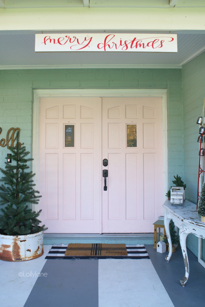 Loving these Christmas porch decorating ideas using bottle brush trees, an old truck and vintage pieces! Classic Christmas front porch decoration ideas! #christmas #christmasdecoration #outdoorchristmasdecoration